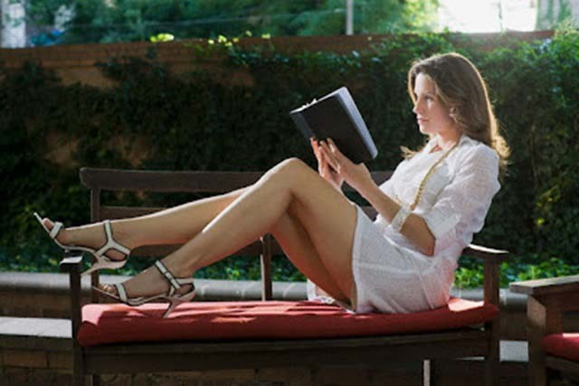 Sexy Woman Reading Book Outside --- Image by © John-Francis Bourke/zefa/Corbis